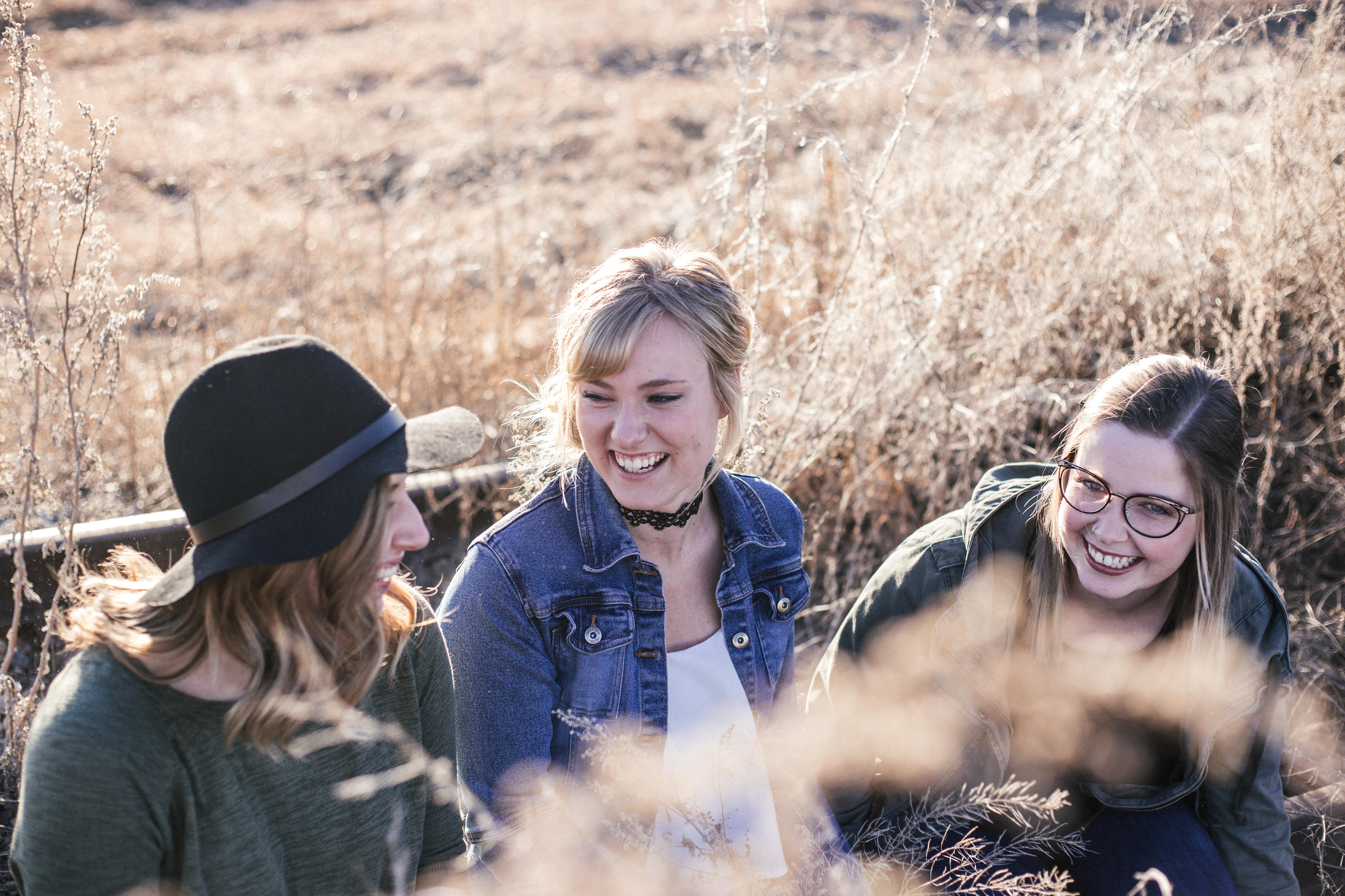 3 happy girls sitting