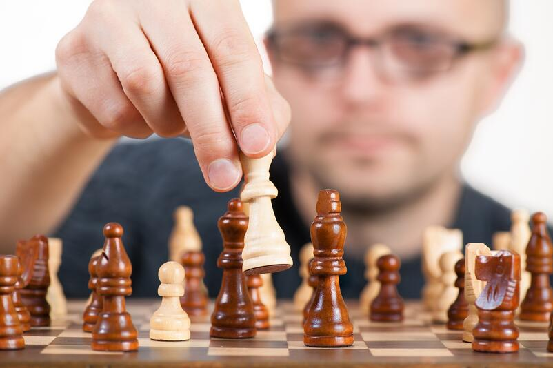 Man playing chess.jpg