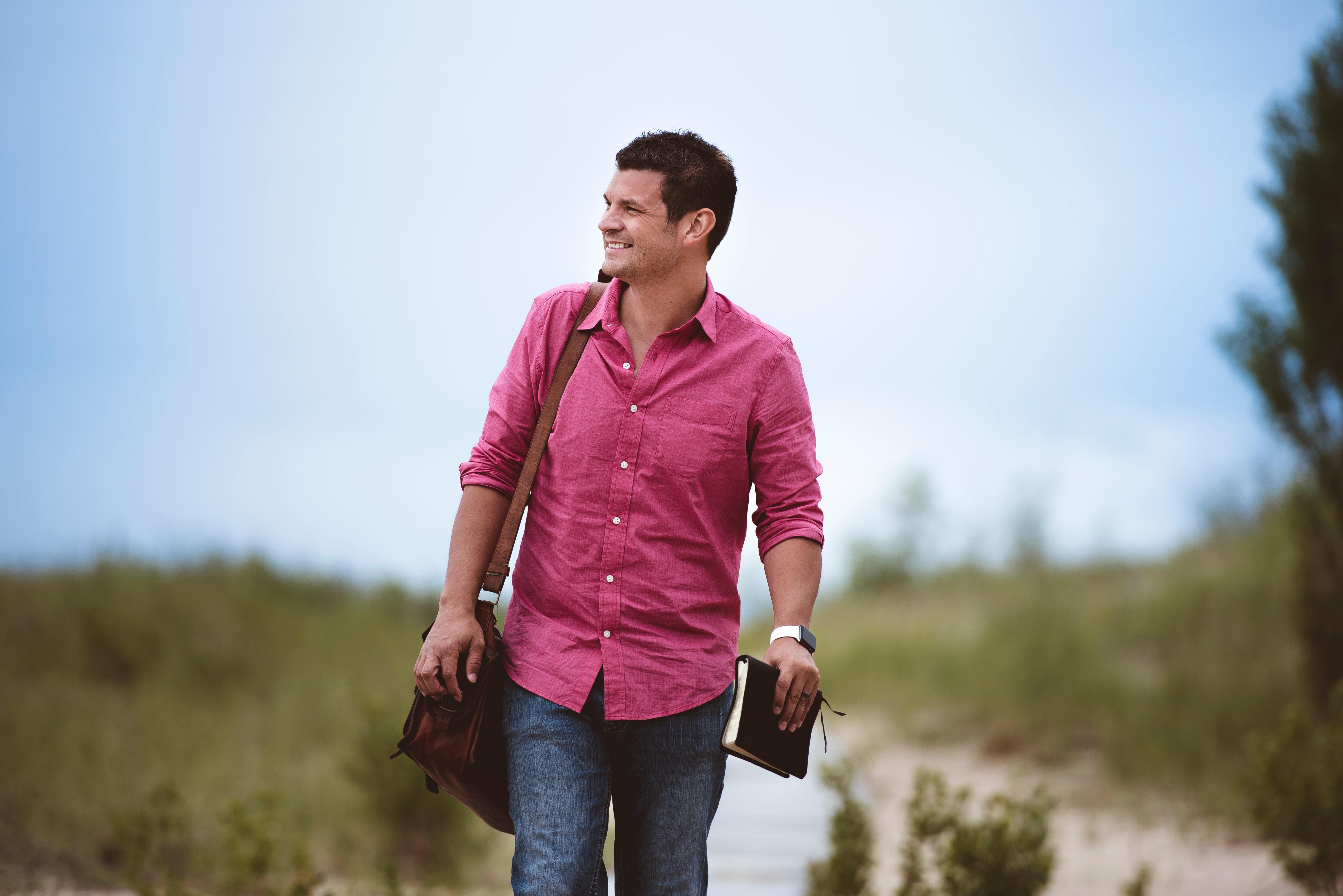 dude in pink shirt walking