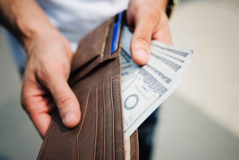 hundred dollar bills in wallet