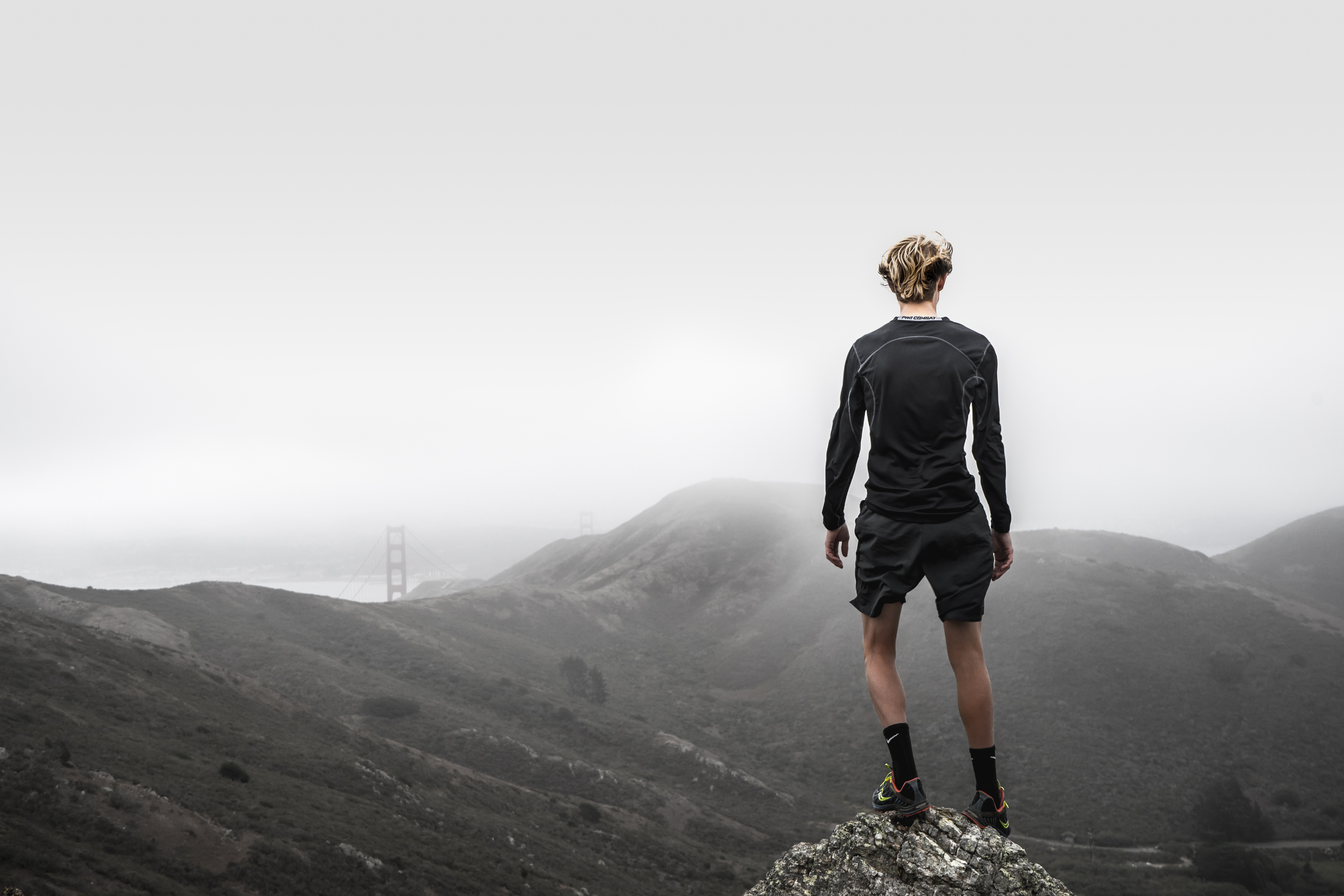 man standing on top of mountain